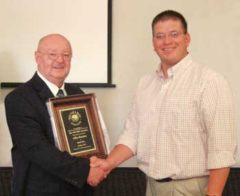 Allin Butcher receives the Dairy Calf and Heffer Association's 2011 Outstanding Industry Recognition Award